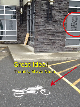 Some businesses offer free motorcycle parking.  This example is at a Steve Nash fitness centre.